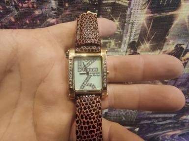 Женские часы ROMANSON DL5122QLRG WH